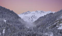 Sunset in the Tyrolean mountains (laurahilhorst) Tags: austria mountains tirol ski wintersport trees sunset colors pink nikon nikond5000 hills pfunds snow snowing clouds travel mountaintop landscape landscapephotography nikonphotography