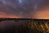 Looking For Islands (Rob Pitt) Tags: wirral dee marshes neston sky clouds marsh cheshire outdoor landscape field plant grass cloud ripples silhouette uk england great british water lake long exposure tokina 1116 750d light pollution flash