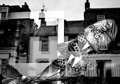 Reflection in a window (picsbyCaroline) Tags: window reflection fish town sculpture bright silver shadows black white