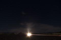 high beam (alzn) Tags: astrophotography deathvalley nationalpark stars desert california californiadesert nighttimephotography pentax tripod headlight automobile mountains