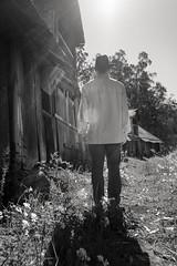 witness to change (Super G) Tags: nikon237 selfportrait abandoned barn backlit standing hat grass building wood flare
