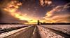 The long road to the East. (Alex-de-Haas) Tags: 11mm aurorahdr d750 dutch hdr holland irix nederland nederlands netherlands nikon noordholland photomatix westfrisia westfriesland art artistic artistiek beautiful betoverend bevroren boerenland cloud clouds cold daglicht daylight desolate farmland fire flat frozen heaven hemel kou kunst landscape landschap licht light lucht mooi plat polder skies sky sneeuw snow sunrise verlaten vuur water winter wolk wolken wonderful zonsopgang