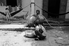 Chores no. 1 (gergelytakacs) Tags: angkor angkorwat asia cambodge cambodia fareast kampuchea khmer kingdomofcambodia siemreap bw blackandwhite boy bystander calle candid children city clothes detergent documentary doorway flâneur girl hammock home house kids lady laundry mom monochrome pants photo photography public rue space strada stranger strasenfotografie street streetphotographer streetphotography streetphotgraph streetphotgrapher streetphotgraphy streetphoto streets streetscape temple travel ulica unposed urban urbanphoto urbanphotographer urbanphotography utcafotó wash washing water woman yard улица רחוב ក្រុងសៀមរាប ព្រះរាជាណាចក្រកម្ពុជា អង្គរវត្ត