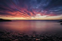 Winter Sunrise (Grant Morris) Tags: sunrise sunriseoverwater longexposure redclouds rocks redsky kirkcaldy ravenscraigbeach scotland grantmorris grantmorrisphotography canon