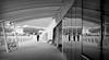 Sul pontile in bianco e nero (Darea62) Tags: reflections blackandwhite mountains landscape bridge lidodicamaiore versilia tuscany toscana bw bench canopy railing