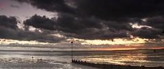 Essex Thorpe Bay (daveknight1946) Tags: essex thorpebay southend riverthames mud beach clouds rainclouds greyclouds sunset breakwater