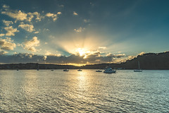 Sunrise Waterscape with Boats and Sun Rays (Merrillie) Tags: daybreak sunrise centralcoast morning nature australia crepuscularrays coastal sea boats landscape newsouthwales clouds earlymorning sun brisbanewater ettalongbeach foreshore sunrays water bay ettalong nsw sky waterscape cloudy coast dawn outdoors