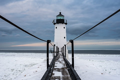 Catwalk (Aaron Springer) Tags: michigan northernmichigan lakemichigan thegreatlakes manisteenorthpierheadlight winter snow ice water clouds pier lighthouse outdoor landscape