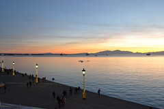 Sunset (rapounzel7) Tags: sunset hour christmas lights sea tranquil urban stroll mount olympus golden clouds people sky boats ships thessaloniki macedonia greece hellas rowing