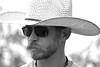 Cowboy (justkim1106) Tags: cowboy man bw monotone portrait blackandwhite cowboyhat sunglasses beard mustache