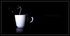 Cup Simple (J Michael Hamon) Tags: cup coffee coffeecup buffalo china porcelain stilllife bw blackandwhite monochrome monochromatic blackbackground steam smoke light shadow reflection hamon nikon d3200 nikkor 40mm tabletop photoborder spoon