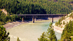 Canadian National Railway Fraser River Bridge at Lytton, from the Rocky Mountaineer, British Columbia, Canada (Black Diamond Images) Tags: cnr fraserriverbridge lytton rockymountaineer rockymountaineerroute fraserriver fraserrivervalley fraserrivercanyon fraserrivergorge britishcolumbia canada canadianrockies vancouvertokamloops canadiantourism armstronggroupltd goldleaf goldleafdomecoach train railroad railway travelphotography landscapes canadiannationalrailway