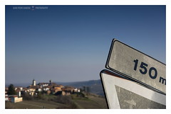 Distances (GP Camera) Tags: nikond7100 tamronsp1750mmf28xrdiiild roadsigns segnalistradali landscape paesaggio village villaggio paese houses case hills colline sky cielo winter inverno light luce shadows ombre lightandshadows lucieombre winterlight luceinvernale softbackground sfondosoffice vignetting shades sfumature focus messaafuoco bokeh sfocato details dettagli silence silenzio quiet quiete whiteframe cornicebianca italy italia piemonte monferrato darktable gimp opensource freesoftware softwarelibero digitalprocessing elaborazionedigitale