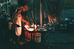 Street Fires (benriley80) Tags: fujifilm fuji nikon f3 nikonf3 ishootfilm film 35mm 50mm nikkor bangkok bkk thai thailand venus800 superia fujisuperia800 fujivenus800 asia street streetphoto hawker streetfood shootfilm stirfry fire fireonfilm grain grainy night nightwalking