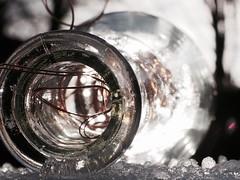 IN  A  BOTTLE (Vivi Black) Tags: outside winter contrast light wire bottle ice inabottle macro macromondays