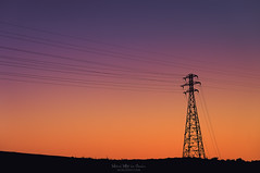 Electric sunset (Mimadeo) Tags: high voltage transmission tower utility power electricity supply cable line sky electrical energy pylon outdoor metal current silhouette wire volt steel electric pole watt sunset evening twilight copyspace beautiful orange dawn dusk