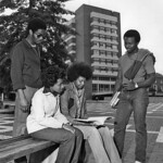 DH Hill rises behind students studying in the late '70s.