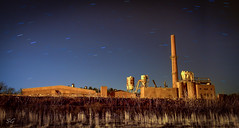 Industry Wasteland (griffin.s.scott) Tags: brickandmortar smokestack rusty decay furniture wasteland barren longexposure startrail nightscape forgotten abandoned outsourced industry factory
