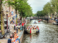 Amsterdam on a warm summer's afternoon! (Digidoc2) Tags: boating canal food people buildings clouds summer bridge bicycles amsterdam crowds restaurants