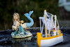 ice mermaid (Mark Rigler -) Tags: mermaid sea water beach fish dolphin seaweed blue sky outside poole dorset england model scale figure outdoors summer ocean boat fishing sailing ship