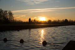 Who let the dog out (Dannis van der Heiden) Tags: sunrise river man person dog water tree sky