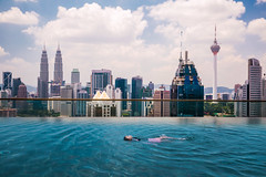 Asian girl swimming in roof top swimming pool in hotel (anekphoto) Tags: vacation urban famous relax high landmark tower rooftop town tall skyscraper beauty woman marina tourist cityscape pool malaysia swimming top kuala lumpur city roof beautiful view hotel travel luxury infinity skyline people business singapore scene sky modern water asia architecture tourism outdoors building background blue young landscape bay holiday kualalumpur