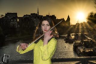 Laure playing violin on Pont des Arts at sunrise