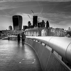 Walking and talking (burnsmeisterj) Tags: olympus omd em1 london street walkietalkie city couple walking mono monochrome blackandwhite