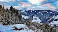 Sunrise in the Alps (DrQ_Emilian) Tags: lanscape view mountains alps trees snow winter white cold outdoors light color sky clouds morning sunrise travel austria hochkönig mühlbach skiresort salzburgerland skiamade cabin