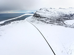 Winter drive (Chris Herzog) Tags: ifttt 500px landscape sea water nature blue ocean road aerial mountain photography explore discover leading line drone bird view iceland luftaufnahme