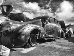 Car heaven (El Cheech) Tags: rust flattire rims forsale parts junk oldcar generalmotors gm pontiac buick blackandwhitephotography clouds sky partingout patina carparts pomonaswapmeet hotrod lowrider suicidedoors classiccar