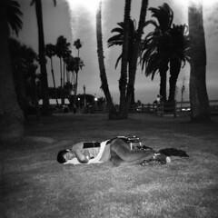 Asleep Under Leaky Sky (Kiyoumars Q. Karimi) Tags: holga la california losangles beach homeless ilford hp5 400 bnw monochrome bw film lomography plastic social documentry