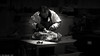 The Cardiff Butcher (Neil. Moralee) Tags: cardiff2018 neilmoralee butcher cardiff meat cut joint dark central market knife skill apron black white mono monochrome bw bandw blackandwhite whiteandblack work working butchery man chop chopping neil moralee panasonic lumix lx7 trade master guild tradesman steak blood