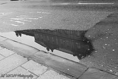 Leeds building reflection. (The friendly photographer.) Tags: art artistic britain blackwhite blackandwhite bw biancoenero beauty brilliant boarlane blancoynegro candid city citycentre d7100 dark england enblancoynegro ennoiretblanc excellentphoto flickrcom flickr building google googleimages gb greatbritain greatphotographers greatphoto image inbiancoenero interesting leeds ls1 leedscitycentre mamfphotography mamf monochrome nikon nikond7100 noiretblanc noir northernengland negro north onthestreet photography photo pretoebranco photograph photographer road reflection reflections sex schwarzundweis schwarz street town puddle uk unitedkingdom upnorth urban westyorkshire wet water yorkshire zwartenwit zwartwit zwart