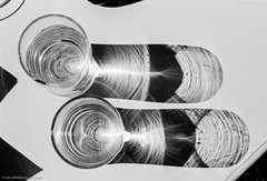 Sunlight through Water (gwpics) Tags: sunshine glass water abstract mono sunlight sun shadow light film monochrome bw blackwhite blackandwhite shadowgram