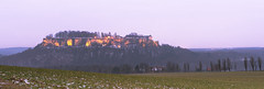 Fortress Königstein at Dusk (redfurwolf) Tags: königstein saxony saxonswitzerland nationalpark landscape nature dusk field germany mountain fortress trees forest sky panorama pano naturalreserve ngc gras redfurwolf sonyalpha sony a99ii sal2470f28za