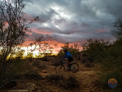 fast past the waning sun (Michael Kenan) Tags: mountain bike bikes trail riding az arizona sunset storms winter storm bicycle 48th state photography desert thunderbird park outdoors exercise sonoran clouds moody