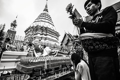Prayers at Doi Suthep temple, Chiang Mai, Thailand
