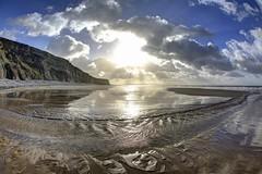 Stranger on the shore (pauldunn52) Tags: beach wick cwm nash glamorgan heritage coast wales wet sand stream reflections patterns sunburst cliffs clouds