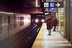 The Arrival (Paul Flynn (Toronto)) Tags: toronto subway ttc train platform city downtown osgood station tracks elevator disabled sign people torontotransitcommission transit transportation winter