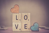 A Day for Love must fill whole year... (Ayeshadows) Tags: love tiles wooden hearts scrabble valentines day balacing balance