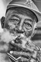 THE SMOKER (CUBA) (Lúg) Tags: black blackandwhite caribbean cigar cigarillo cuba cubano culture editorial ethnic expression face havana havanacuba head lahavana old people perdegas person poor portrait poverty tourism tradition traditional travel white