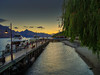 Queenstown goes to sleep (Explored) (Geoff Eccles) Tags: clear warmcolors summer newzealand queenstown water sunset boats lakewakatipu lake tourism vacation dusk