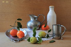 The Memory of Citrus Fruit (Esther Spektor - Thanks for 12+millions views..) Tags: stilllife naturemorte bodegon naturezamorta stilleben naturamorta composition creativephotography art citrus tabletop lemon tangerine leaf pitcher plate mug bottle doily metal pewter winter ambientlight ceramics white yellow orange green silver grey brown estherspektor canon coth5