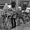 DSCN5804 (1) (Akbar Simonse) Tags: denhaag haag sgravenhage lahaye thehague holland netherlands nederland streetphotography straatfotografie candid people woman children kids smartphone fiets bicycle hat hoed helmet helm vierkant square akbarsimonse zwartwit bw bn monochrome