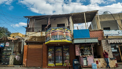 * (Timos L) Tags: house shop small street urban landscape man cellphone beirut lebanon liban beyrouth olympus em5ii panasonic 123528 timosl