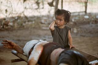 SAIGON Tet Offensive 1968 - Vietnamese child remains close to her injured mother