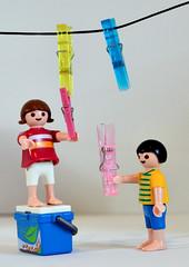 "Let's play ""fasten"" (Raquel Borrrero) Tags: macromondays fastener playmobil pinzaderopa juguete clicks"