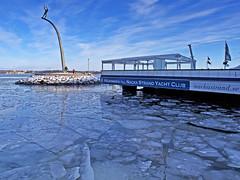 Nacka Strand in Stockholm (Franz Airiman) Tags: stockholm sweden scandinavia is ice snö snow winter vinter isflak icefloe freezing nacka nackastrand fountain sculpture fontän skulptur gudfaderpåhimmelsbågen nackastrandyachtclub minusgrader