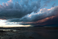 Antelope Island Shower (claeshields) Tags: weather rain clouds storm stormy sunset color pink water utah